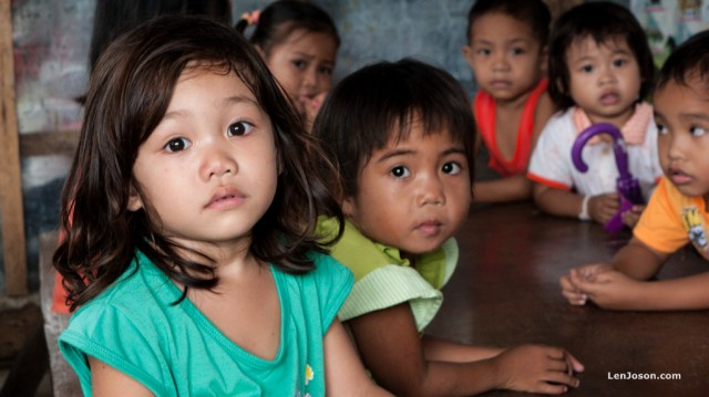 These little kids were wondering who we were—the strangers—intruding into their day care center. I guess this was the reason why there were no smiles when we came in at first.